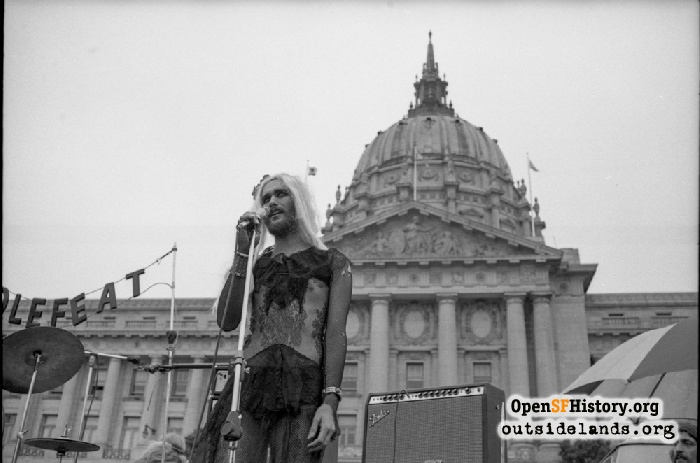 Performer on stage in front of City Hall during Gay Freedom Day Parade, June 30, 1974.
