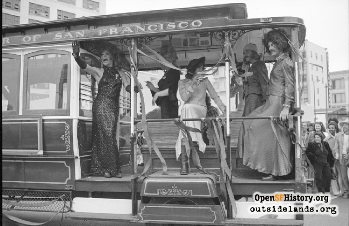 Celebrants on motorized cable car at O'Farrell and Polk during Gay Freedom Day Parade, June 30, 1974.
