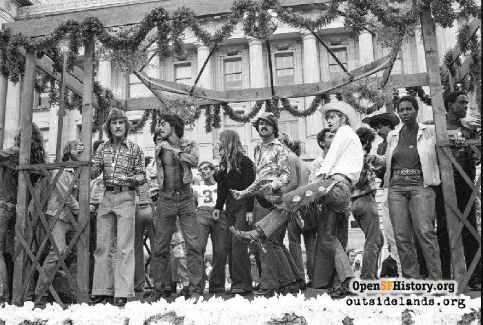 People dancing on stage or float in front of Civic Center during Gay Freedom Day Parade, June 30, 1974.