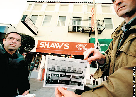 SF Chronicle Photo: Richard Brandi and Woody LaBounty show off a historical photo, 2002